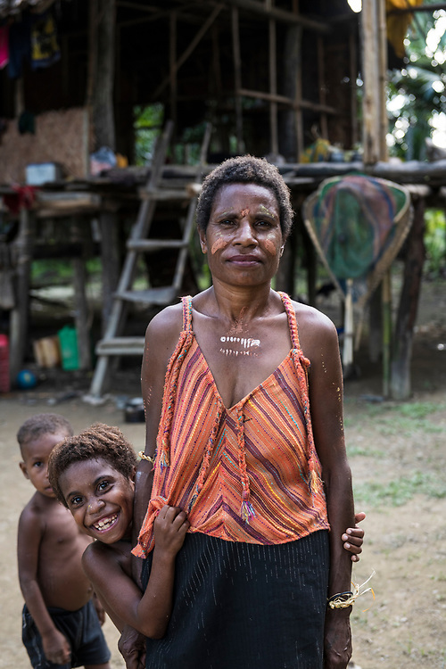 Lucy, standing with granddaughter Carisa, age 7, in Yar village, East Sepik Province, Papua New Guinea