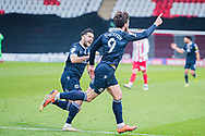 GOAL 1-2 Morecambe forward Cole Stockton (9) celebrates putting Morecambe ahead with Morecambe defender Stephen Hendrie (3)  during the EFL Sky Bet League 2 match between Stevenage and Morecambe at the Lamex Stadium, Stevenage, England on 6 February 2021.