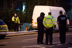 """©London News pictures... 17/11/2010. Police cover a body with a tarpaulin. One person has died today (Wed) and a number of people have been arrested in a """"serious incident"""" in Sunningdale, Berkshire."""
