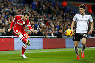 Adam Le Fondre of Cardiff crosses the ball past Richard Smallwood of Rotherham. Skybet football league championship match, Cardiff city v Rotherham Utd at the Cardiff city stadium in Cardiff, South Wales on Saturday 6th December 2014<br /> pic by Mark Hawkins, Andrew Orchard sports photography.