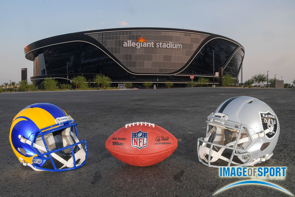 "The Wilson NFL ""Duke"" football  is seen with Los Angeles Rams and Las Vegas Raiders helmets outside of of Allegiant Stadium, Monday, Sept. 14, 2020, in Las Vegas. (Dylan Stewart/Image of Sport)"