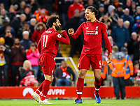 Liverpool's Mohamed Salah celebrates scoring his side's fifth goal with Virgil van Dijk<br /> <br /> Photographer Alex Dodd/CameraSport<br /> <br /> The Premier League - Liverpool v Huddersfield Town - Friday 26th April 2019 - Anfield - Liverpool<br /> <br /> World Copyright © 2019 CameraSport. All rights reserved. 43 Linden Ave. Countesthorpe. Leicester. England. LE8 5PG - Tel: +44 (0) 116 277 4147 - admin@camerasport.com - www.camerasport.com