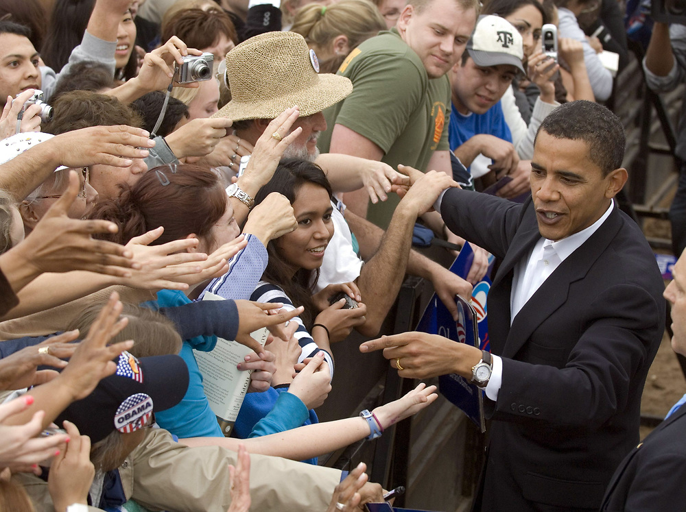 Austin, Texas: February 23, 2007: U.S. Senator Barack Obama (D-Illinois) works the crowd at his second major rally after announcing his candidacy for President of the United States last month. Obama spoke through a slight drizzle to a crowd of about 17,000 at Austin's Town Lake.    ©Bob Daemmrich /