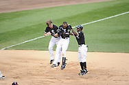 CHICAGO - JULY 09:  Gordon Beckham #15 (L), Alexei Ramirez #10 and Juan Pierre #1 (R) of the Chicago White Sox celebrate after Ramirez drove in the game winning run in the bottom of the ninth inning against the Minnesota Twins on July 9, 2011 at U.S. Cellular Field in Chicago, Illinois.  The White Sox defeated the Twins 4-3.  (Photo by Ron Vesely)  Subject: Gordon Beckham;Juan Pierre;Alexei Ramirez
