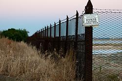 Il complesso produttivo delle saline è situato nel comune italiano di Margherita di Savoia (nome dato dagli abitanti in onore alla regina d'Italia che molto si adoperò nei confronti dei salinieri) nella provincia di Barletta-Andria-Trani in Puglia. Sono le più grandi d'Europa e le seconde nel mondo, in grado di produrre circa la metà del sale marino nazionale (500.000 di tonnellate annue).All'interno dei suoi bacini si sono insediate popolazioni di uccelli migratori e non, divenuti stanziali quali il fenicottero rosa, airone cenerino, garzetta, avocetta, cavaliere d'Italia, chiurlo, chiurlotello, fischione, volpoca..Recinzione dell'area che ospita le strutture di lavorazione del sale. Nell'area è vietata la caccia e la pesca, come si può leggere dal cartello.