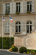 View of town hall with French flags in foreground, Epernay, France