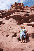 Two year baby boy mountain climbing