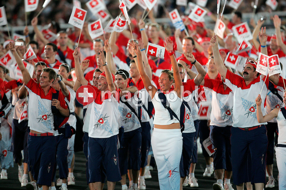 The Swiss Olympic team wave national flags during the team parade of the opening ceremony of the Athens 2004 Olympic Games in the Olympic Stadium, Friday 13 August 2004.    (Photo by Patrick B. Kraemer / MAGICPBK)