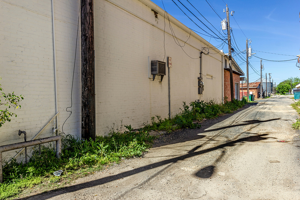 Empty alleyway, USA<br /> <br /> The original inhabitants of the area were the Coahuiltecan people in 1881 Non-indigenous settlers to the area came from Alsace-Lorraine, Germany, Belgium and Mexico. <br /> In the early 1920s, Hondo was the scene of two bank robberies carried out by the Newton Gang, the most successful outlaws in U.S. history. Both bank heists occurred the same night.