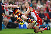 Ted Richards of the Swans tackles Patrick Dangerfield of the Crows during the AFL Round 06 match between the Sydney Swans and the Adelaide Crows at the SCG, Sydney. (Photo: Craig Golding/AFL Media)