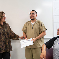 Katrina Marti, a case manager at the McKinley County Adult Detention Center presents Ricky Chavirez with a certificate for graduating from their 28 day substance abuse treatment program, Wednesday Oct. 3, 2018 at the McKinley County Jail.