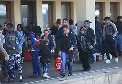 © London News Pictures. 06/09/2015. A group of migrants and volunteers are seen at Wien Westbahnhof train station, Vienna, Austria, September 6 2015.  Hundreds of migrants have resumed their journey through Austria to Germany after Hungary's decision on Friday to let them through. Picture by Paul Hackett/LNP