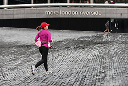A jogger on the South Bank in London.