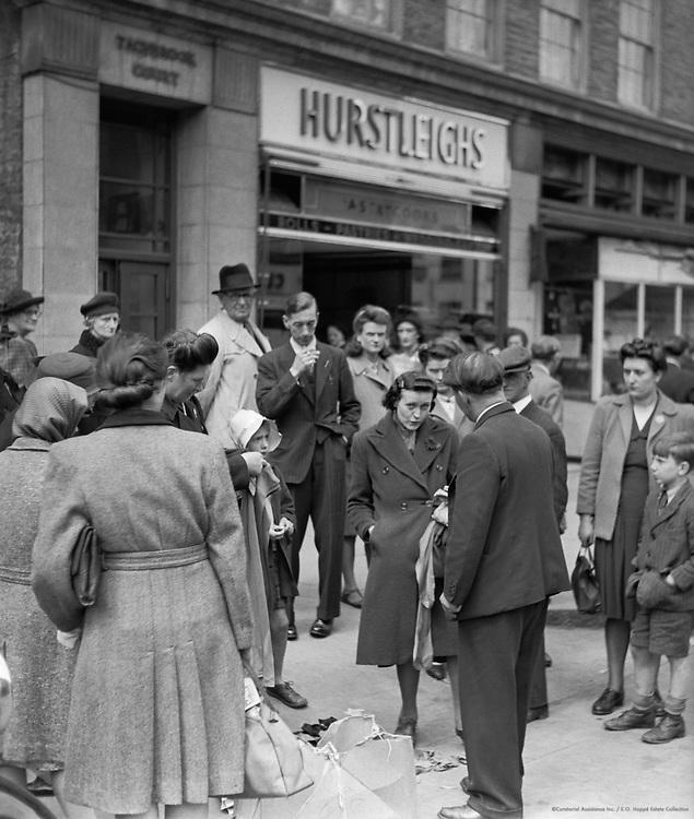 Crowd around a Street Trader, London, 1940