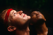 Sweating in tropical heat, two young men volunteers gaze up to the roof of the rainforest canopy whilst on a Raleigh International expedition in Brunei, Borneo. This is one of the remotest and most dangerous habitats on the planet and will have been a life-changing experience for them and their friends from all over the world who will have raised several thousands of sponsored Pounds for the privilege of spending two months away from a dull, comfortable life at home, rather than building community projects like bridges or schools. Raleigh International is a charity that provides adventurous and challenging expeditions for people from all backgrounds, nationalities and ages, especially young people. Over the last 23 years, 30,000 people have been involved in more than 250 expeditions to over 40 countries.