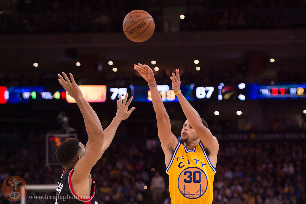 November 17, 2015; Oakland, CA, USA; Golden State Warriors guard Stephen Curry (30) shoots the basketball against Toronto Raptors guard Cory Joseph (6) during the third quarter at Oracle Arena. The Warriors defeated the Raptors 115-110.
