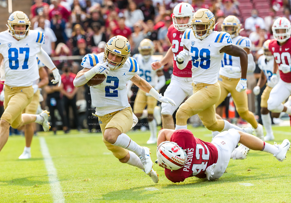PALO ALTO, CA - SEPTEMBER 26:  Kyle Phillips #2 of the UCLA Bruins returns a punt during an NCAA Pac-12 college football game against the Stanford Cardinal on September 26, 2021 at Stanford Stadium in Palo Alto, California, long snapper Bailey Parsons #42 of Stanford attempts to tackle.  (Photo by David Madison/Getty Images)
