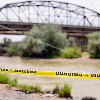082515       Cable Hoover<br /> <br /> Caution tapes marks a landing on the San Juan River in Shiprock Wednesday.