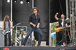 June 20, 2018 - Oshkosh, Wisconsin, U.S - GRAHAM DELOACH, MICHAEL HOBBY and ZACH BROWN of A Thousand Horses during Country USA Music Festival at Ford Festival Park in Oshkosh, Wisconsin (Credit Image: © Daniel DeSlover via ZUMA Wire)