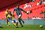 Fred Woodhouse of Stockton Town (9) and Tom Moran of Thatcham Town (6) battle for the ball during the FA Vase match between Stockton Town and Thatcham Town at Wembley Stadium, London, England on 20 May 2018. Picture by Stephen Wright