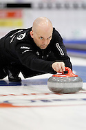 Jon Mead, third on Jeff Stoughton's team throws his rock in the team's first draw Wednesday.  The 2011 GP Car and Home Players' Championship ran April 12-17 at the Crystal Centre, Grande Prairie, AB..11-04-13, Photo Randy Vanderveen, Grande Prairie, Alberta.