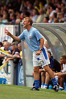 Photo: Alan Crowhurst.<br />Wycombe Wanderers v Lincoln City. Coca Cola League 2. 23/09/2006. Lincoln coach John Schofield gives the orders.