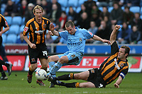 Photo: Pete Lorence.<br />Coventry City v Hull City. Coca Cola Championship. 03/03/2007.<br />Michael Doyle is tackled by Ian Ashbee.