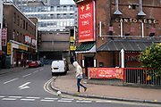 Man playing with a football in Chinatown in Birmingham city centre is virtually deserted due to the Coronavirus outbreak on 31st March 2020 in Birmingham, England, United Kingdom. Following government advice most people are staying at home leaving the streets quiet, empty and eerie. Coronavirus or Covid-19 is a new respiratory illness that has not previously been seen in humans. While much or Europe has been placed into lockdown, the UK government has announced more stringent rules as part of their long term strategy, and in particular social distancing.