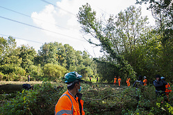 Denham, UK. 29th September, 2020. Tree surgeons working on behalf of HS2 Ltd, facilitated by around two dozen security guards, fell trees in Denham Country Park for works connected to the HS2 high-speed rail link. Anti-HS2 activists based at the nearby Denham Ford Protection Camp and protesting against the destruction of the woodland contend that the area of Denham Country Park currently being felled is not indicated for felling on documentation supplied by HS2 Ltd.