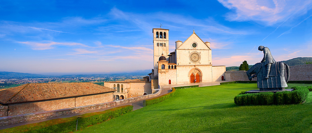 The upper facade of the Papal Basilica of St Francis of Assisi, ( Basilica Papale di San Francesco ) Assisi, Italy .<br /> <br /> Visit our ITALY HISTORIC PLACES PHOTO COLLECTION for more   photos of Italy to download or buy as prints https://funkystock.photoshelter.com/gallery-collection/2b-Pictures-Images-of-Italy-Photos-of-Italian-Historic-Landmark-Sites/C0000qxA2zGFjd_k .<br /> <br /> Visit our MEDIEVAL ART PHOTO COLLECTIONS for more   photos  to download or buy as prints https://funkystock.photoshelter.com/gallery-collection/Medieval-Middle-Ages-Art-Artefacts-Antiquities-Pictures-Images-of/C0000YpKXiAHnG2k