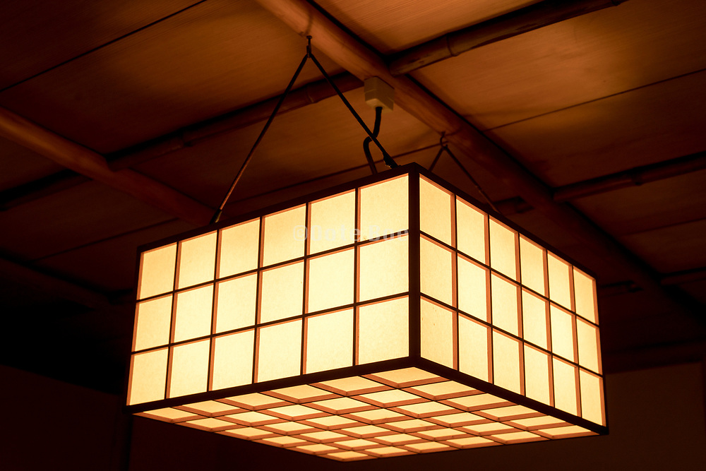 light hanging from the ceiling in an old traditional Japanese garden teahouse