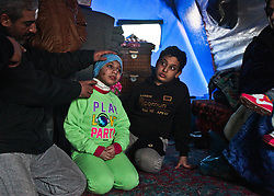 December 4, 2016 - Mosul, Iraq - Mahmoud Yahia, 41, shows off his daughter Naja Mahmoud's, 9, wounds sustained after she and her family were hit by an ISIS suicide car bomb at their home in Mosul. As Iraqi Security Forces move to clear the city of the terror network, refugees try adjust to life at Hassan Sham 3 Camp in Kurdistan Region with minimal health care after such trauma. (Credit Image: © ZUMA Wire via ZUMA Wire)