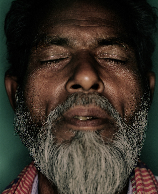 Portrait of a bearded asian man with his eyes closed