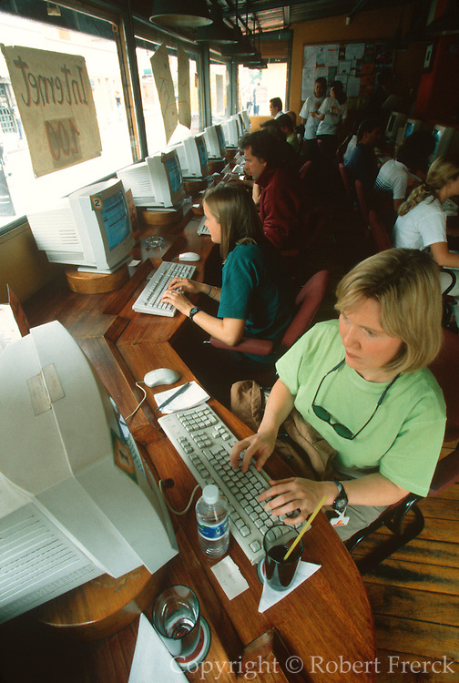 ECUADOR, QUITO, TECHNOLOGY students and travelers in the Papaya.net Cyber Cafe on Avenida Juan Leon Mera in the New Town area of the city