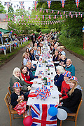 Street party with Union Jack flags and bunting to celebrate Queen's Diamond Jubilee at Swinbrook in The Cotswolds, UK