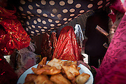 """Bortsoq"", a fried dough, is brought inside the celebratory yurt, at the wedding celebration at Kitshiq Aq Jyrga...Trekking through the high altitude plateau of the Little Pamir mountains (average 4200 meters) , where the Afghan Kyrgyz community live all year, on the borders of China, Tajikistan and Pakistan."