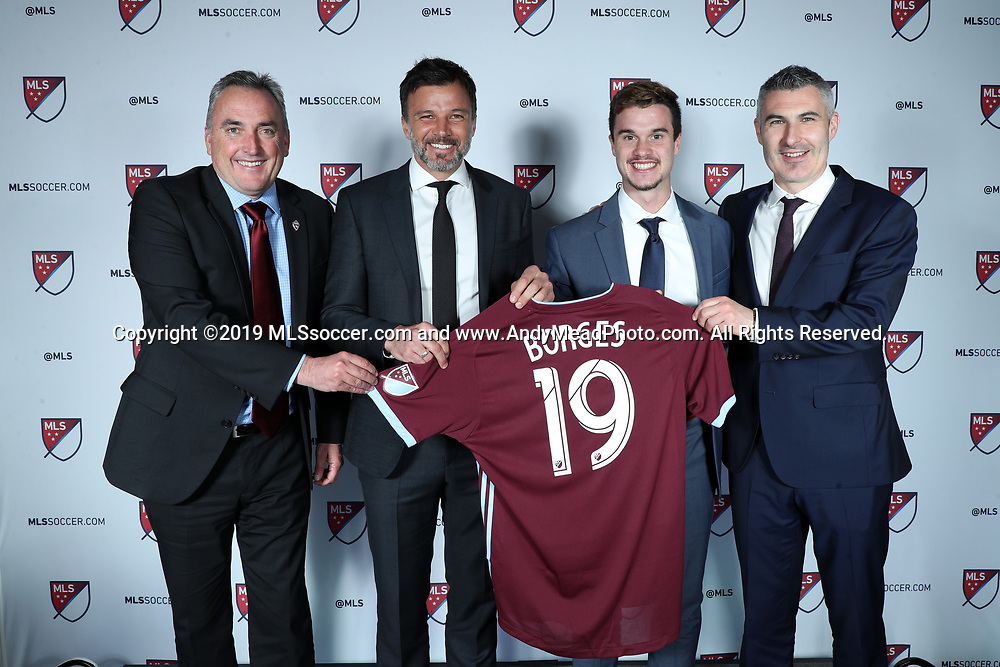 CHICAGO, IL - JANUARY 11: Marcello Borges was taken with the 28th overall pick by the Colorado Rapids. With (left),   senior director of soccer development Brian Crookham, head coach Anthony Hudson (second from left), and general manager Padraig Smith (right). The MLS SuperDraft 2019 presented by adidas was held on January 11, 2019 at McCormick Place in Chicago, IL.