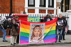 © Licensed to London News Pictures. 05/04/2019. London, UK. Protesters with a large banner outside Ecuadorian Embassy in Knightsbridge. Media reports state that the Ecuadorian Embassy plan to remove Julian Assange, Wikileaks founder from the embassy within days. Julian Assange claimed political asylum in the Ecuadorean Embassy in June 2012 after he was accused of rape and sexual assault against women in Sweden. Photo credit: Dinendra Haria/LNP