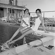 Y-600705.  Miss Seaside and Miss Portland at Seaside. July 5, 1960. Seasider motel & pool. Miss Oregon pageant. (neither won the title)