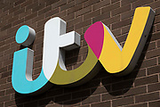 ITV Television Centre sign on 15th July, 2021 in Leeds, United Kingdom. Owned by ITV Yorkshires parent company, ITV plc, the television centre is home to the studios that produce the popular British soap opera, Emmerdale.
