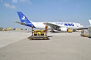 Israel, Ben-Gurion international Airport maintenance vehicle on the Tarmac. An MNG Cargo plane in the background