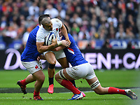 Rugby Union - 2020 Guinness Six Nations Championship - France vs. England<br /> <br /> England's Jonathan Joseph wrapped up by the French defence, at The Stade de France, Paris.<br /> <br /> COLORSPORT/ASHLEY WESTERN