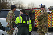 © Licensed to London News Pictures. 10/02/2014. Old Windsor, UK. Firefighters and members f the military plan action. Flooding in OLD WINDSOR in Berkshire today 10th February 2014 after the River Thames burst its banks. The Environment Agency has issued 14 Severe Flood Warnings alone the Thames. Photo credit : Stephen Simpson/LNP