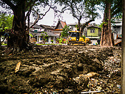 04 JULY 2017 - BANGKOK, THAILAND:   Construction equipment works on making a new park in what used to be housing in Pom Mahakan. The final evictions of the remaining families in Pom Mahakan, a slum community in a 19th century fort in Bangkok, have started. An ad hoc group of housing advocates, historic preservationists and academics have asked the city to allow the remaining residents to stay and city officials have said they might allow people who can prove that their families have lived in the fort since before the 1950s, when the city got title to the land from the Thai military, will be able to stay.   PHOTO BY JACK KURTZ