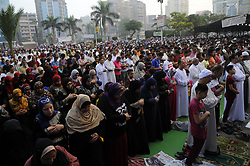 June 25, 2017 - Giza, Egypt - Egyptian Muslim men and women gather for a prayer during the Muslim holiday of Eid al-Fitr, inMostafa Mahmoud Mosque, Giza, Egypt, 25 June 2017. Egyptian Muslims offer Eid al-Fitr prayers to celebrate the end of Ramadan , Eid-al Fitr marks the end of the holy month of Ramadan and Muslims traditionally visit the graves of their relatives and loved ones and present toys and sweets to the children on that day. Muslims around the world were celebrating the holy month of Ramadan until 24 June by praying during the night time and abstaining from eating, drinking, and sexual acts daily between sunrise and sunset. Ramadan is the ninth month in the Islamic calendar and it is believed that the Koran's first verse was revealed during its last 10 nights. (Credit Image: © Mohamed Mostafa/NurPhoto via ZUMA Press)
