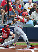 ATLANTA, GA - JULY 27:  Right fielder Carlos Beltran #3 of the St. Louis Cardinals follows through on a swing while catcher Brian McCann #16 of the Atlanta Braves looks on during the game at Turner Field on July 27, 2013 in Atlanta, Georgia.  (Photo by Mike Zarrilli/Getty Images)
