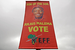 Wednesday 8th May 2019.<br /> Sinenjongo High School, Joe Slovo Park,<br /> Milnerton, Cape Town, <br /> Western Cape, <br /> South Africa.<br /> <br /> SOUTH AFRICAN GENERAL ELECTIONS 2019!<br /> <br /> SOUTH AFRICAN PROVINCIAL AND NATIONAL ELECTIONS 2019! <br /> <br /> An EFF (Economic Freedom Fighters) political party banner with the image of party leader Julius Malema on it along with the words 'Son Of The Soil' and 'Vote EFF' as it hangs from a lamppost outside the voting station at Sinenjongo High School, Joe Slovo Park near Milnerton, Cape Town, Western Cape, South Africa.  <br /> <br /> Registered South African Voters head to the various IEC (Independent Electoral Commission) Voting Stations where they are registered to vote as they cast their votes and take part in voting and other activities on Voting Day 8th May 2019 during the South African General Elections 2019. Voters from across the nation stood in queue's along with many others to vote in the Provincial and National Elections being held in South Africa on Wednesday 8th May 2019.   <br />  <br /> Copyright © Mark Wessels. All Rights Reserved. No Usage Without Permission.<br /> <br /> PICTURE: MARK WESSELS. 08/05/2019.<br /> +27 (0)61 547 2729.<br /> mark@sevenbang.com<br /> studioseven@mweb.co.za<br /> www.markwesselsphoto.com