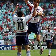 USA's Brian McBride celebrates scoring USA's first goal with Claudio Reyna