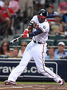 ATLANTA, GA - AUGUST 30:  Right fielder Jason Heyward #22 of the Atlanta Braves follows through after connecting for a sacrifice fly during the game against the Washington Nationals during the game at Turner Field on August 30, 2011 in Atlanta, Georgia.  (Photo by Mike Zarrilli/Getty Images)
