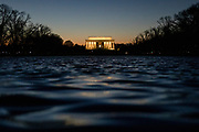 WASHINGTON, DC - JANUARY 08: The sun sets behind the Lincoln Memorial and Reflecting Pool on the National Mall on January 8, 2020 in Washington, DC.